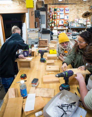 Students learning to how to build birdhouses in a Home ReSource workshop