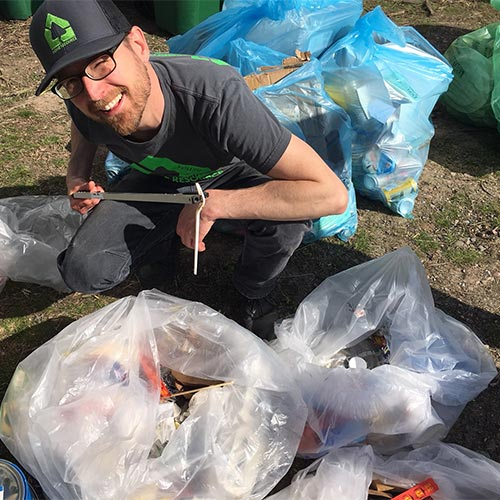 Jeremy Drake sorting items on Earth Day 2018